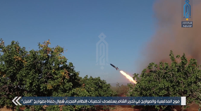 The Headquarters for the Liberation of Al-Sham fires a self-manufactured rocket at Syrian army positions northwest of Hama (Ibaa, July 6, 2019)