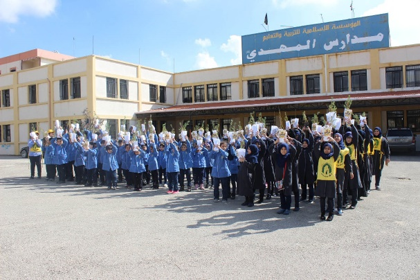 Jihad al-Bina's planting campaign in the Al-Mahdi school in Al-Qatrani (Al-Ahed website, March 15, 2018)
