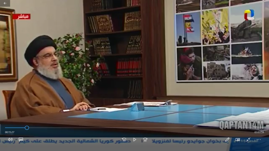 Hezbollah leader Hassan Nasrallah during the interview. On the table in front of him is a map of Israel. To the right are pictures illustrating the threats he referred to during the interview. They included an attack on an Israeli navy vessel; a building in Haifa that was directly hit by a rocket during the Second Lebanon War; Israeli soldiers crying during a funeral and demonstrators carrying pictures of Iranian leader Khamenei (al-Manar, July 12, 2019, uploaded to the QAPTAN14M YouTube channel).
