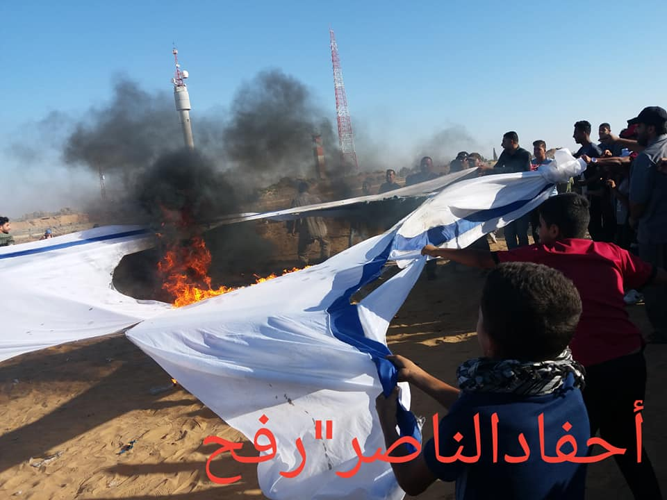 Palestinians burn Israeli flags and tires in eastern Rafah (Ahfad al-Nasr – Rafah Facebook page, July 19, 2019).