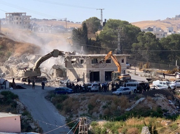 Israeli security forces raze illegally-built houses in accordance with an Israeli Supreme Court ruling (Wafa, July 22, 2019).