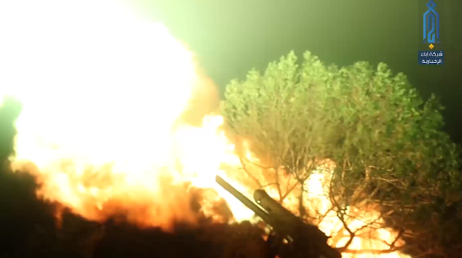 Field gun of the Headquarters for the Liberation of Al-Sham fires at Syrian army positions in Al-Qasabiya before the attack (Ibaa, July 21, 2019).