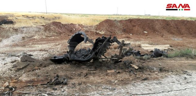 Wreckage of an APC of the Headquarters for the Liberation of Al-Sham which was destroyed by the Syrian army on the road leading to the village of Al-Qasabiya (SANA, July 21, 2019)