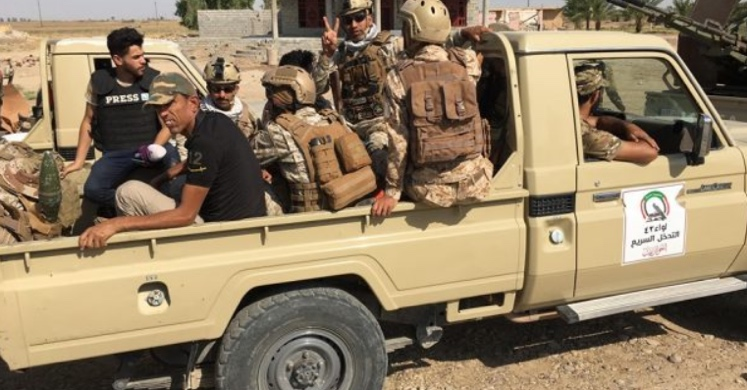 Popular Mobilization vehicle with fighters and a communications operative in the area north of Baghdad (al-hashed.net, July 21, 2019)