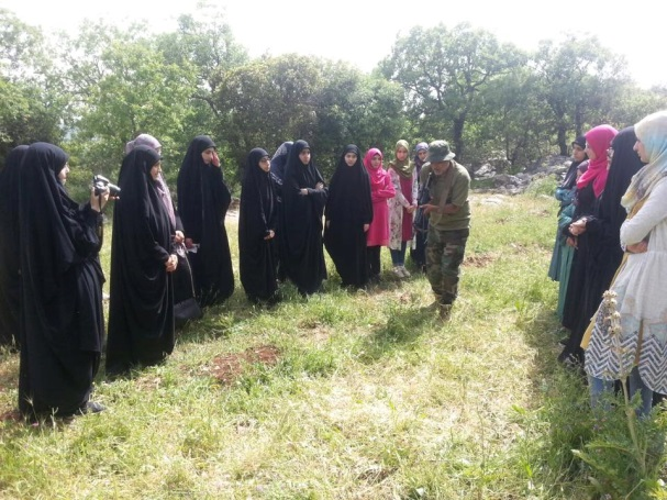 "Hezbollah fighter meets with female activists of the Education Mobilization in southern Lebanon as part of a ""jihadi trip."" The trip included visits at the grave of a shahid and a Hezbollah post. During the visit, the fighter talked with them about ""jihadi spirit"" and the virtues of Sayyida Zaynab (the daughter of Imam Ali and Fatima, the Prophet Muhammad's daughter, revered by the Shiites) and the connection with Imam Al-Mahdi (Facebook page of the Education Mobilization, The Second Region [in southern Lebanon], May 4, 2016)"
