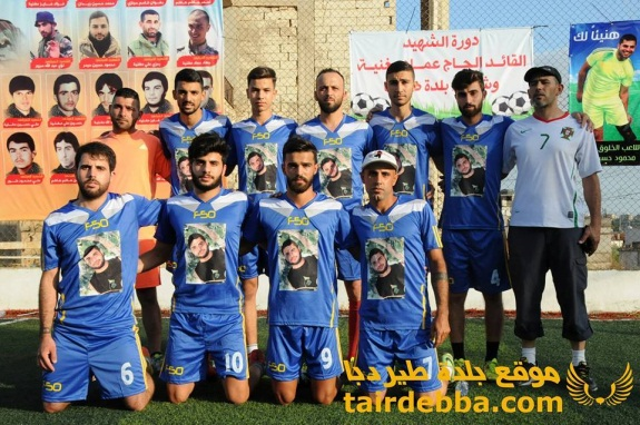 "Soccer team named after a Hezbollah shahid whose picture appears on the team's uniform. The sign in the background reads, ""Tournament of the shahid commander Al-Hajj Imad (?)…"" (Facebook page of the village of Tair Debba in southern Lebanon, July 9, 2016)."