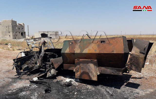 Self-manufactured armored vehicle of the rebel organizations which was destroyed in the village of Al-Jebeen (SANA, July 30, 2019)