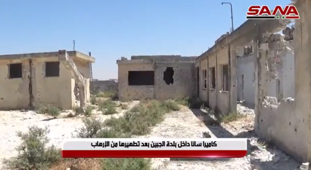 "Buildings hit in Al-Jebeen, which was retaken by the Syrian army on July 29, 2019. The Arabic caption reads, ""SANA's camera inside the village of Tal Mileh after it was liberated from terrorism"" (SANA, July 30, 2019). The buildings show considerable damage from metal pellets. In the ITIC's assessment, the damage may have been caused by the airstrikes, in which large quantities of such pellets may have been used."