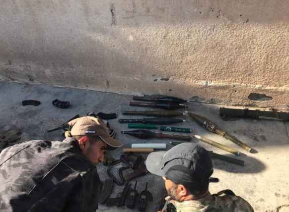 ISIS weapons and communications devices seized by the SDF forces in the village of Abu Hamam (SDF Press, July 27, 2019).
