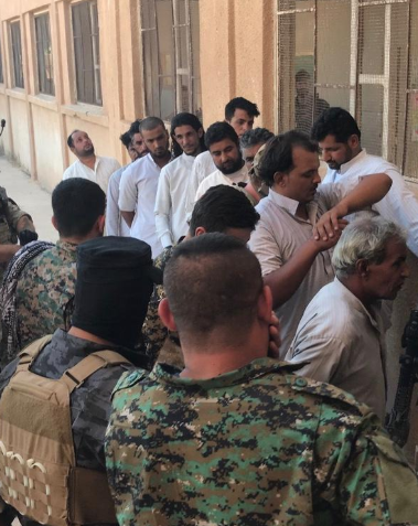 ISIS operatives captured in the village of Abu Hamam.