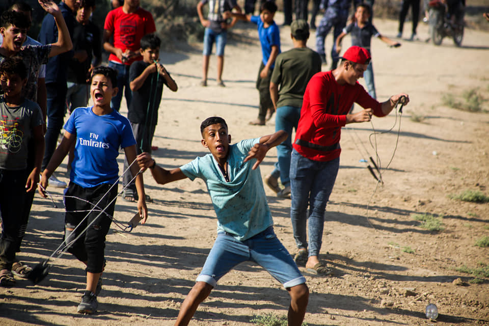 Children and adolescents throw stones east of Gaza City (Supreme National Authority of the Great Return March Facebook page, August 2, 2019).