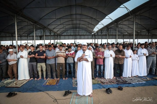 Mass prayer in the return camp in eastern Khan Yunis.