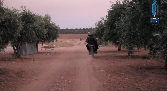 Motorcycles with operatives of the Headquarters for the Liberation of Al-Sham on their way to Tal Tarei (Ibaa, August 13, 2019)
