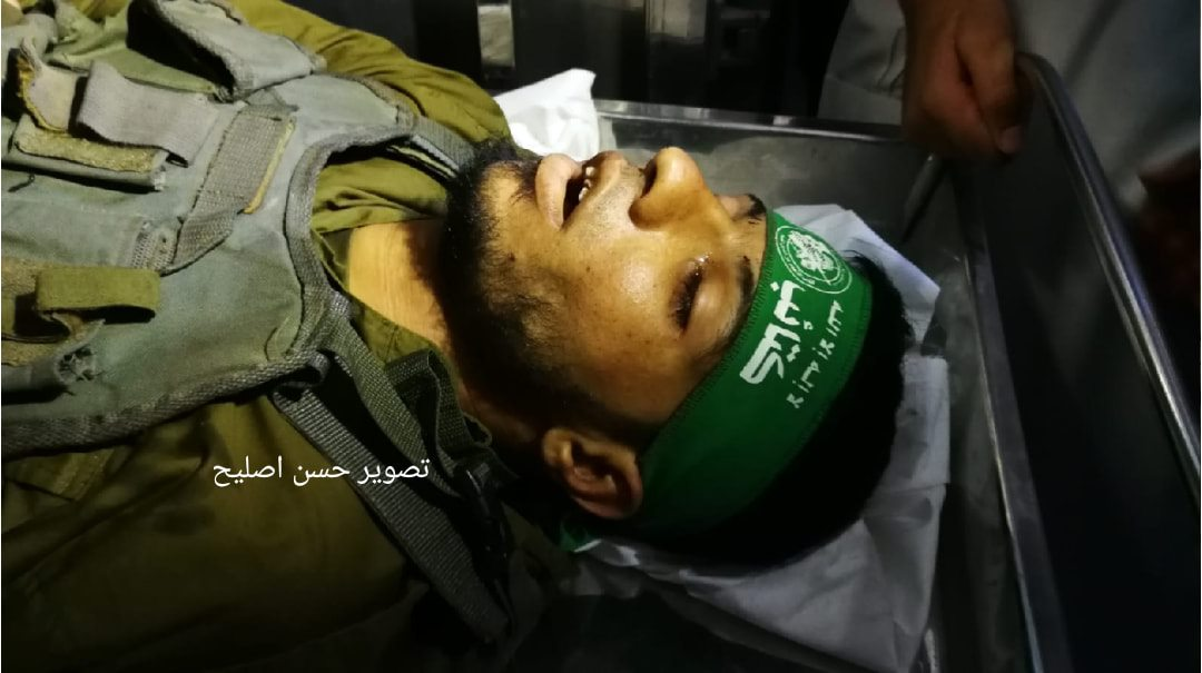 The body of Marwan Nasser with a green Hamas headband (Facebook page of journalist Hassan Aslih, August 11, 2019).