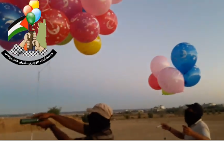 The Sons of al-Zawari unit in eastern Khan Yunis prepares incendiary balloons for launching into Israeli territory.