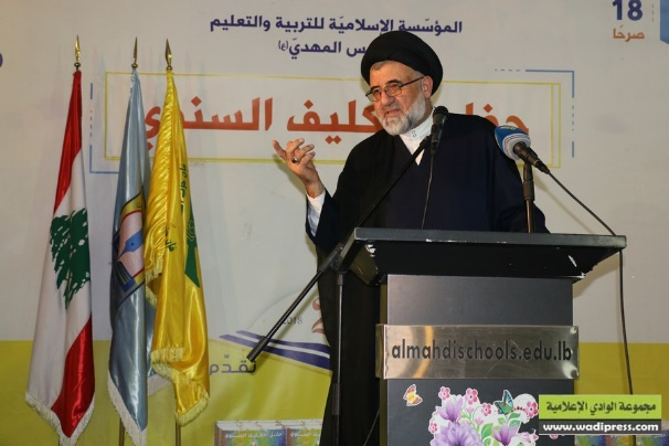 Sayyid Ali Fahs, the official in charge of Hezbollah's Preaching and Cultural Activity Unit, delivering a speech at a coming of age ceremony for girls in the Al-Mahdi school in Nabi Chit in the Bekaa Valley (Wadi Press, April 4, 2018)