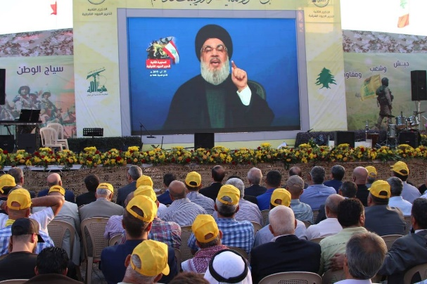 The audience watching Nasrallah's speech projected onto a giant monitor (al-Manar, August 25, 2019).