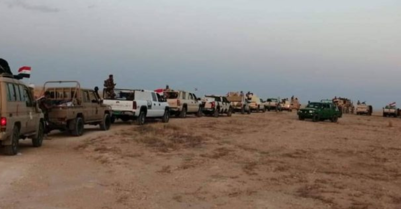 Mounted Popular Mobilization and Iraqi army force in a desert area during the security operation (al-hashed.net, August 25, 2019)