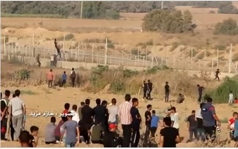 Rioters climb the security fence east of the al-Bureij refugee camp (pictures from a video on the Facebook page of photographer Hazem Muzeid, August 30, 2019).