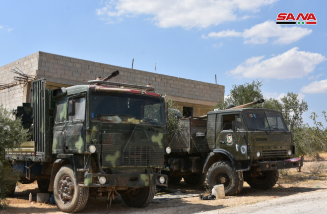 Trucks carrying guns and a tank seized by the Syrian army during the battles (SANA, August 31, 2019)