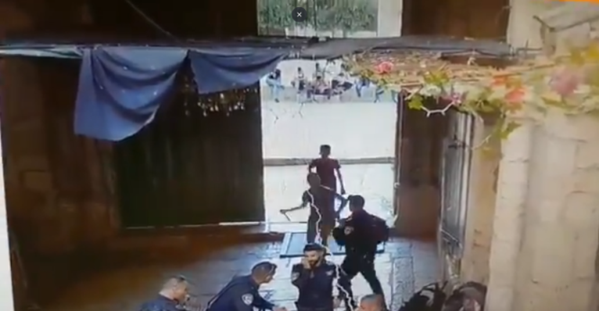 Naseem Abu Rumi and his friend stabbing the policeman (Israel Police Force Spokesperson's Unit, August 15, 2019).