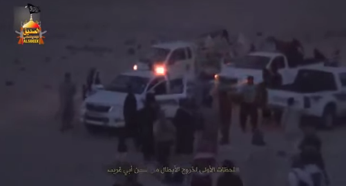 Photo from a video showing ISIS vehicles waiting for the evacuation of the escaping prisoners outside Abu Ghraib Prison.