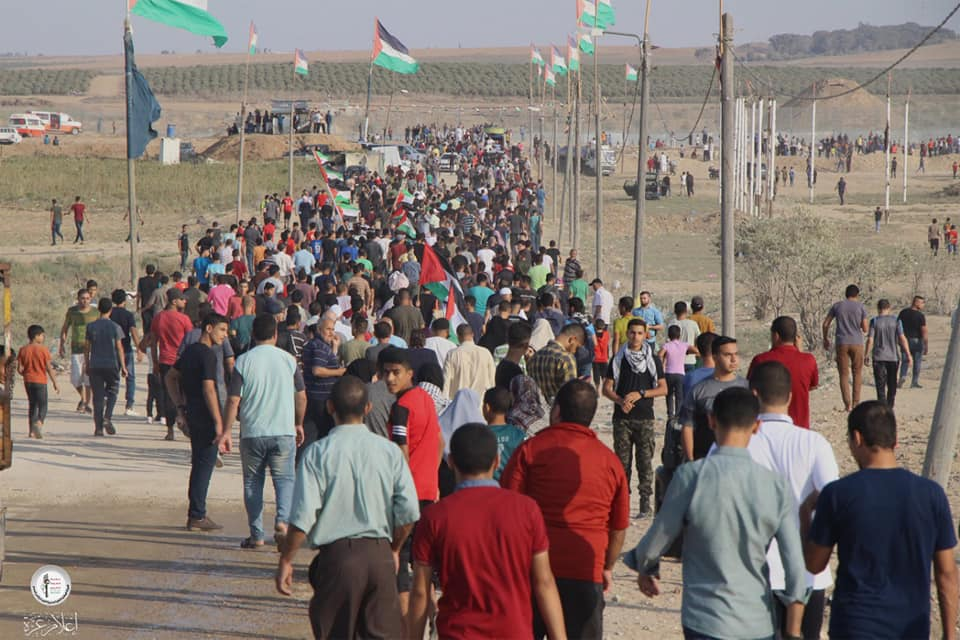 Palestinian demonstrators making their way to the return camp in eastern Gaza City.