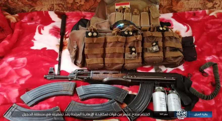 The Iraqi counterterrorism fighter's service weapon, cartridges and combat vest, seized by ISIS in the area of Al-Dujail (Telegram, October 22, 2019)