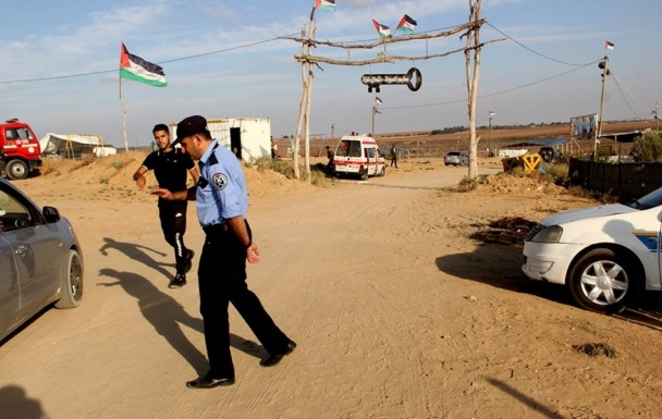 Operatives of Hamas' security forces direct traffic at the entrance to a return camp in the Gaza Strip.