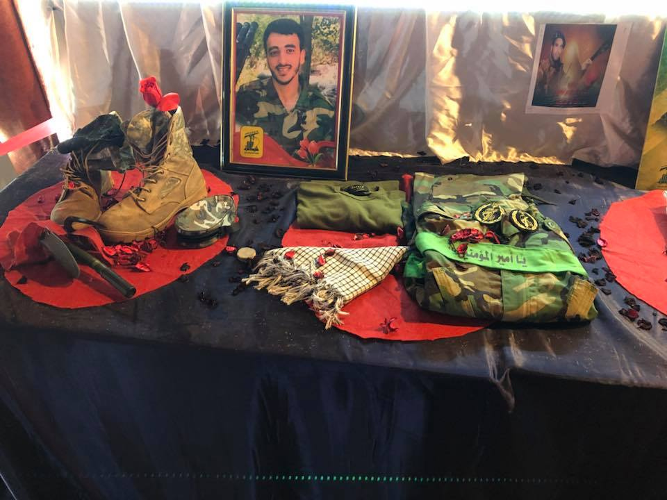 Belongings of Hezbollah's shahids at an exhibition in memory of shahids at the detention facility in Al-Khiyam. On the uniforms, there are unit badges of the Iranian Revolutionary Guards (Facebook)