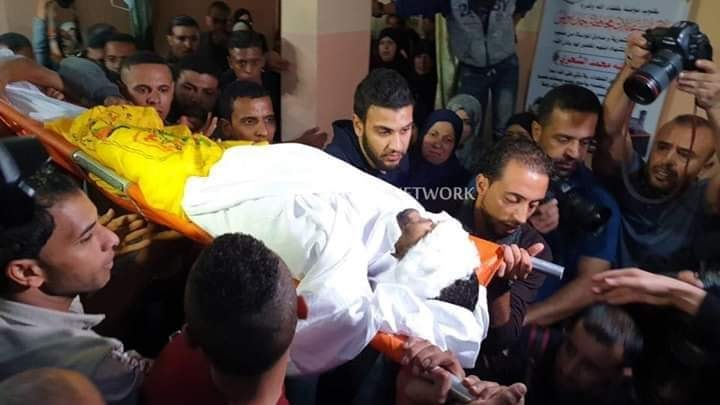 The funeral held for Ahmed Muhammad al-Shahari, his body draped with a Fatah flag (Facebook page of the information department of the Fatah branch in western Khan Yunis, November 2, 2019).