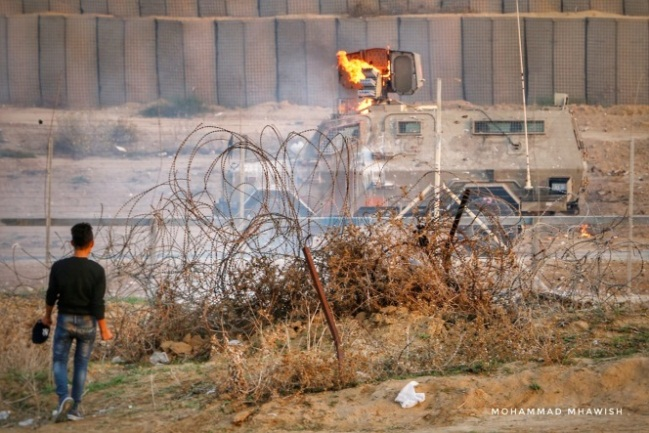 A Molotov cocktail catches fire on an IDF jeep in the eastern part of the al-Bureij refugee camp (Facebook page of Mohammad Mhawish, November 8, 2019).