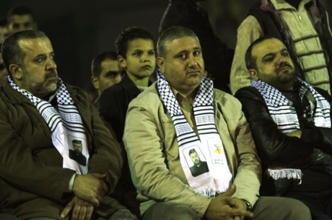 Taysir al-Jaabari (center) sits next to Bahaa Abu al-Atta (right).