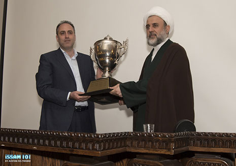 The president of the Al-Ahed Sport Club, Adv. Tamim Suleiman, awards Hezbollah leader Hassan Nasrallah the championship cup won by the soccer team, through Hezbollah's Sheikh Nabil Qaouq (Al-Akhbar daily, May 18, 2017)