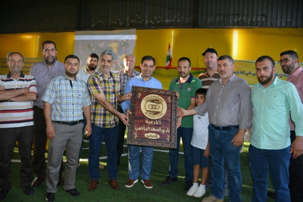 The inauguration ceremony of the Sports Academy. The logo of the Al-Ahed Sport Club is visible in the middle of the photo (Janoub Media website, no date mentioned)