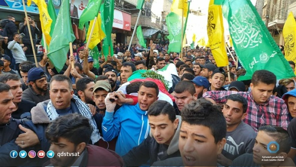 Hamas and Fatah flags at the funeral held for Fahed al-Astal (al-Quds TV Twitter account, November 30, 2019).
