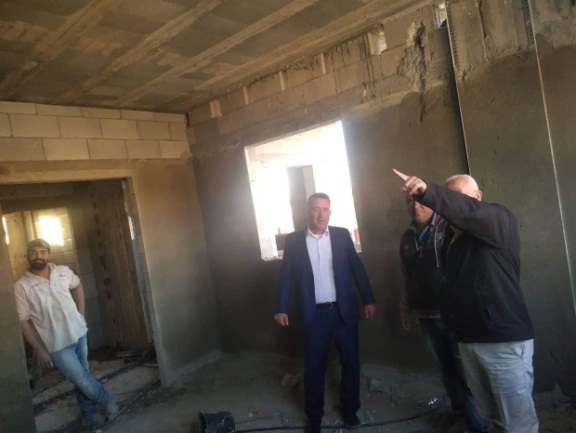 Abd al-Satar Awad, secretary of the Fatah branch in Salfit (at the right in both pictures) visits the construction site of the house being built for the family of Omar Abu Layla in al-Zawiya (Facebook page of the Fatah branch in Salfit, November 27, 2019).