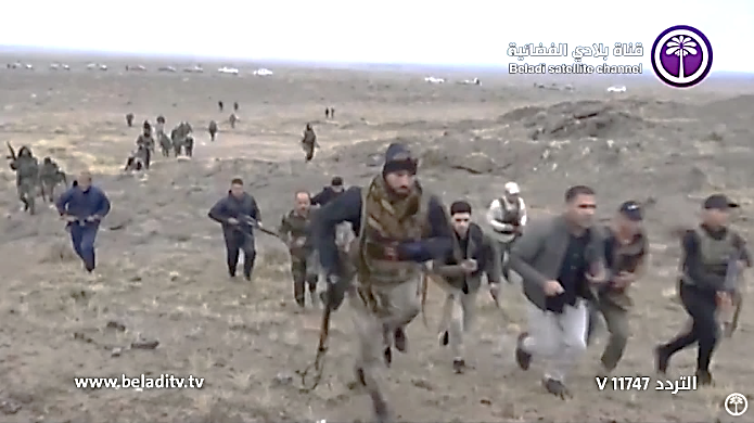 Popular Mobilization fighters searching the mountainous region in the Diyala Province (from the Iraqi Baladi TV channel, December 10, 2019).