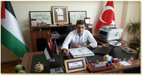 Jihad Yaghmour in his office at the Association of Jerusalem and Our History Association, which serves as the cover for his covert activities (picture from the Association website)