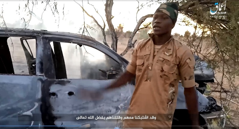 ISIS operative near the burned vehicle in which seven Nigerian soldiers were killed (Telegram, December 27, 2019)