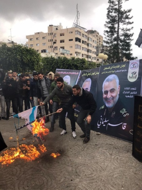 Israeli and American flags are burned in the mourning tent erected for Qassem Soleimani in Gaza City (Lamess Twitter account, January 4, 2020).