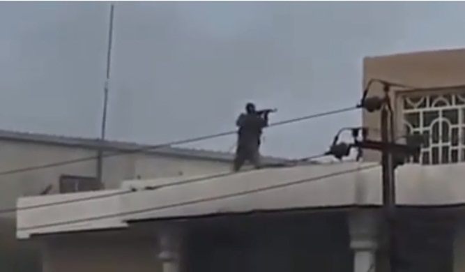 Asa'ib Ahl al-Haq operative Wissam al-Alyawi firing at the demonstrators. He was wounded and captured by the protesters, who lynched him (Al-Hurra, October 27, 2019).
