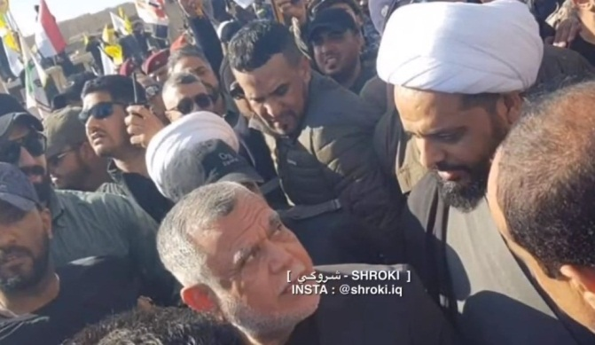 Khazali during the demonstrations in front of the embassy, standing next to Hadi Al-Amari, head of the Badr militia (YouTube, December 31, 2019)