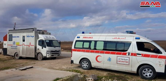 Syrian regime's ambulance and mobile clinic awaiting civilians who wish to leave through one of the humanitarian crossings in the Idlib region (SANA, January 13, 2020)