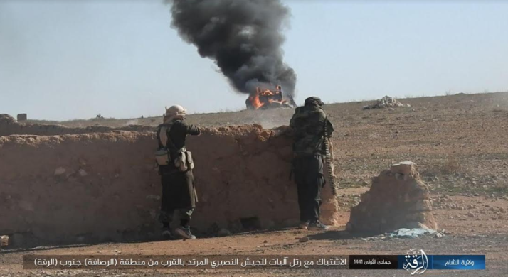 ISIS operatives shooting at a Syrian army convoy.