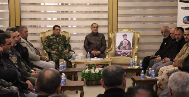 Meeting on security and military priorities held by the Popular Mobilization commanders at the headquarters of the deputy commander of the Popular Mobilization. On the chair in the middle there is a photo of Qassem Soleimani and Abu Mahdi al-Muhandis, who were killed in the US attack on January 3, 2020 (al-hashed.net, January 13, 2020).