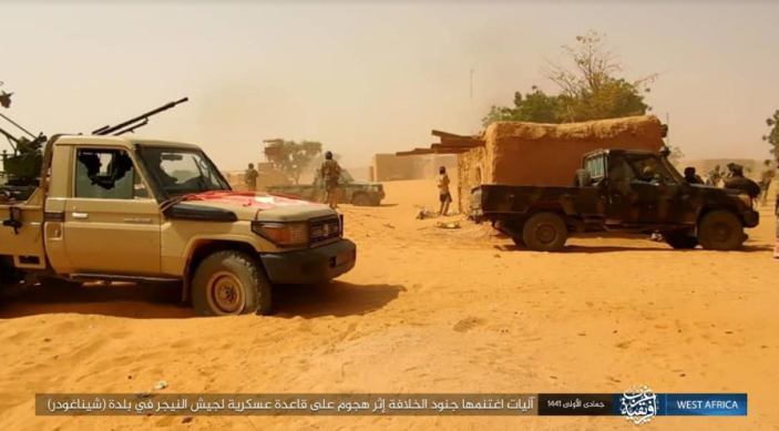 ISIS operatives near two Niger army vehicles seized by them during the attack (Telegram, January 14, 2020).