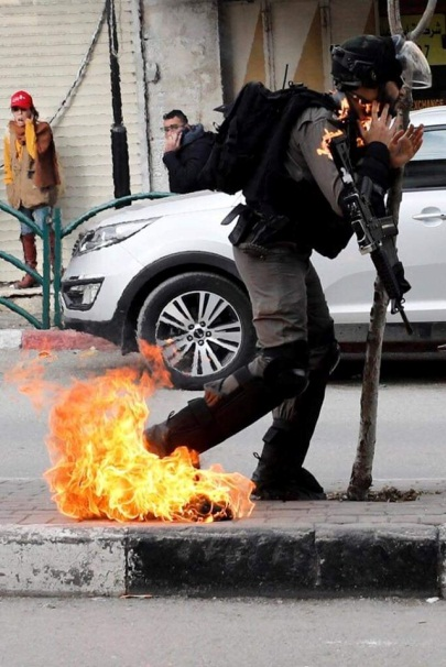 Border Police fighter wounded by a Molotov cocktail thrown by Palestinians during riots in Hebron (QudsN Facebook page, February 3, 2020).