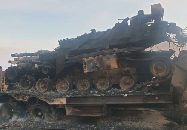Turkish army tank destroyed by Syrian artillery fire at the Taftanaz military airfield. Left: Two Turkish trucks which were destroyed (Khotwa, February 10, 2020)