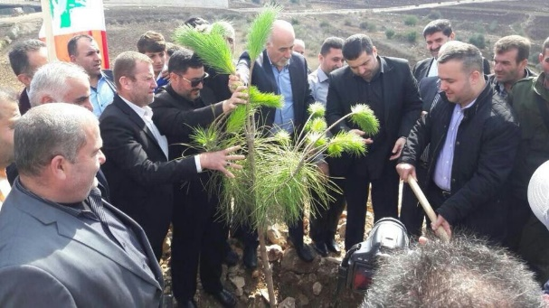 Hezbollah member of the Lebanese parliament Hassan Fadlallah (right, holding spade) plants a tree at a Green Without Borders' event in the village of Ayta al-Shab in the western sector of south Lebanon, near the Israeli border (al-Khayam local news website, November 5, 2017).